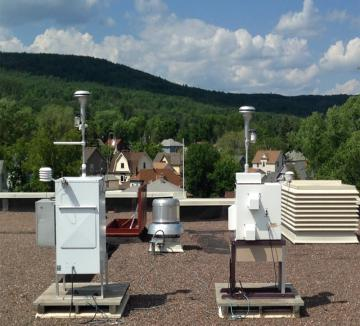 Air monitoring equipment on a rooftop.