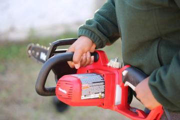 Electric landscaping equipment, like this electric chainsaw, is good for clean air.