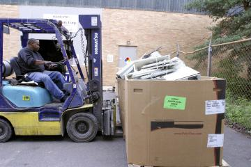 Forklift moving box filled with ewaste