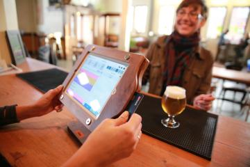 A point-of-sale terminal helps replace paper receipts.