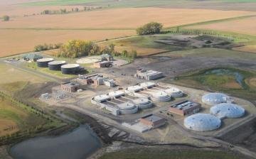 Aerial view of a wastewater treatment facility surrounded by farm fields